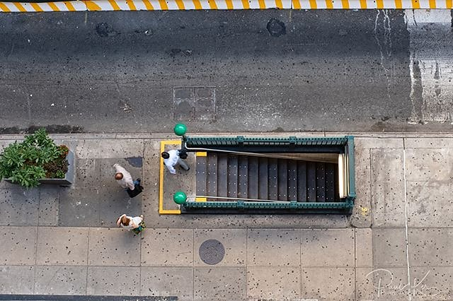a view from above. Looking dow at a typical NY subway entrance/exit